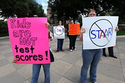 Protesters express opposition to standardized testing.