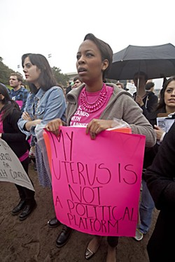 Despite loud opposition from women and Planned Parenthood advocates like Lesli Simms, shown above at a rally last February, the state of Texas continues battling the nearly 100-year-old organization.