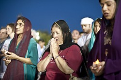 Austin's Sikh community gathered at the Capitol Tuesday for a candlelight vigil in memory of the six victims killed in the weekend shooting at a temple in Wisconsin.
