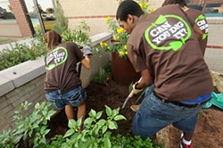 Students in the garden at John B. Connally High School in Pflugerville