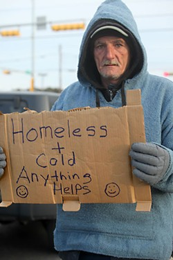 A homeless man hustles for change