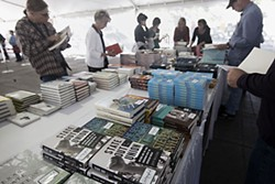 Book lovers browse through stacks during last weekend's Texas Book Fest. See Kimberley Jones' blog wrap-up (with a link to more photos) at<b> <a href=http://www.austinchronicle.com/blogs/books/2012-10-29/paging-through-the-texas-book-festival/>austinchronicle.com/books</a></b>.