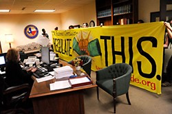Occupy Austin members make a surprise visit Nov. 19 to the Texas Railroad Commission, which regulates the state's oil and gas, in support of a human blockade effort against construction of the tar sands oil pipeline, which would run from Canada through East Texas to the Gulf Coast.