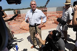 Mayor Lee Leffingwell, speaking at the WTP4 site in 2011, defended the project's $15 million overrun.