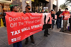 A crowd gathers outside Sen. John Cornyn's office on Dec. 10. The protesters sought the renewal of tax cuts for the middle class, and the protection of such social programs as Medicare, Medicaid, and Social Security.