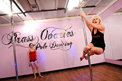 Miss Sophie (r) teaches the Pole Level 3 class at Brass Ovaries