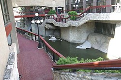 The creek flows through a walkway at the Hilton Garden Inn on Fifth Street.