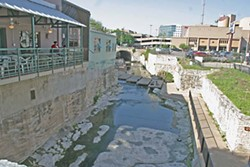 The Boiling Pot patio on Sixth Street overlooks the creek.