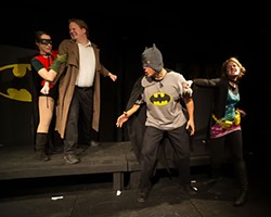 KA-POW! Batman (Aaron Saenz) takes it on the chin from Barbara Gordon (Mia Iseman) while Robin (Kaci Beeler) restrains the Commissioner (Jordan Maxwell).