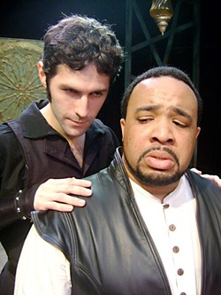 I'll pour this pestilence into his ear: Iago (Andrew Bosworth) works on Othello (Trevor Bissell)