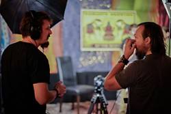 Mike Mann (l) and Greg Zeschuk (r) chatting on set at the Whip In