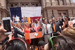 Sens. Wendy Davis and Leticia Van de Putte, joined by Democratic legislators, receive a rousing welcome from the crowd at Monday's rally.