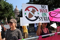 A rally against a potential U.S. strike on Syria also brought out anti-Obama forces during a protest Aug. 31 at the state Capitol.