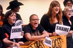 Yatzel Sabat (c) and other protesters outside the HB 2 signing ceremony on July 18, 2013