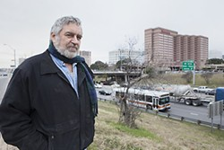 Bo McCarver, chair of Blackland Community Development Corporation, by the I-35 wall Downtown