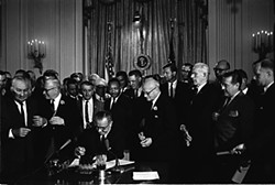 President Lyndon Baines Johnson signs the Civil Rights Act, July 2, 1964.
