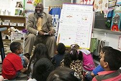 Texas Education Agency Commissioner Michael Williams enjoys a laugh with Zavala Elementary students at a literacy fair May 2.