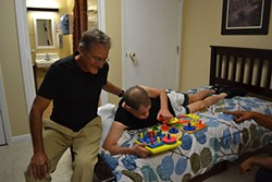 Forrest Novy visits his brother, Wayne, who suffers from behavioral and physical challenges, at the Austin State Supported Living Center.
