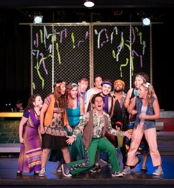 Come sing about love!: Adam Munoz (center) leads the Austin Theatre Project cast of <i>Godspell</i>