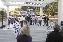 Opponents of Prop. 2's constitutional ban on gay marriage rallied in Wooldridge Park on Monday to warn that faulty wording in the proposition could threaten all marriages.