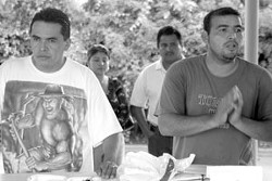 AVATACO Vice-President Esmael Lozano (l) and President Polo Cadena speak to around 20 taco stand vendors at a meeting at Plaza Saltillo.