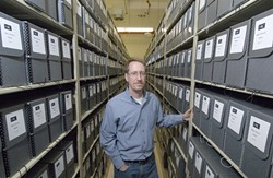 Lead archivist Steve Mielke surrounded by more than 1,000 boxes of Norman Mailer material
