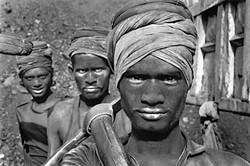 <i>Workers emerging from a coal mine, Dhanbad, Bihar state, India, </i>1989