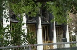 The charred Governor's Mansion