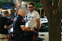 Austin Police Officer Jason Mistric arrests Nathaniel Hill during a recent Critical Mass ride.