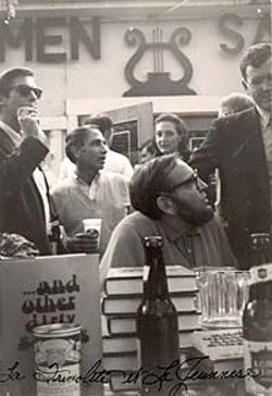 Holding a booksigning at Scholz Garten (in this case, for Larry L. King's  <i>… and other dirty stories</i> in 1968) is the epitome of Mad Dog style:  a little beer with your books. The man smoking behind King (seated)  is artist Fletcher Boone, and behind him, Bill Brammer. <p>(Larry L. King Archives, Southwestern Writers Collection, Southwest Texas State University)