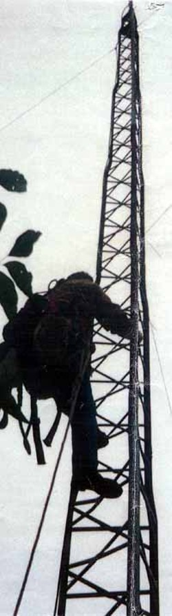 An FCC contractor climbs the Free Radio Austin broadcast tower during the October 10, 2000, raid to begin dismantling the tower.<br><i>Photo courtesy Free Radio Austin</i>