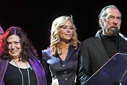 Susan Antone (left) and arts patrons Eloise and John Paul DeJoria introduce Denny Freeman.