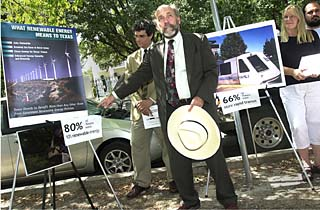 Peter Altman (l) of the S.E.E.D. Coalition and Tom Smitty Smith of Public Citizen promoting renewable energy in front of the Governor's Mansion.