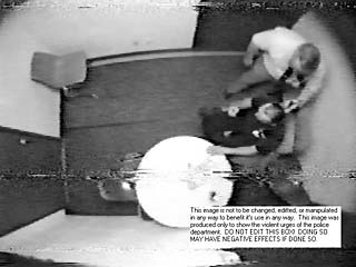 Police videotape of Michael Scott's interrogation apparently shows APD Detective Robert Merrill holding a gun to Scott's head. Merrill testified he was role-playing, and held his fingers to Scott's head while holding his gun in the other hand.