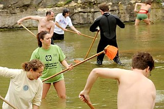 Friends of Barton Springs and other volunteers spent April 22 cleaning Barton Springs Pool as part of a number of Earth Day activities.