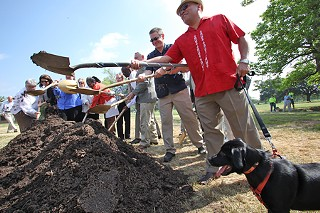Mayor Pro Tem Mike Martinez, under the watchful eye of his dog Chucho, joins in the May 7 groundbreaking of a new $12 million animal center – the Betty Dunkerley Campus – just west of U.S. 183 near Airport Boulevard. The 41,450-square-foot center is slated for completion in late 2011.