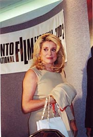 Equally important as seeing the movies is seeing the stars and discovering, for example, that Catherine Deneuve (promoting her new film, <i>8 Women</i>) looks even better in person than she does in the movies.