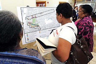 A neighborhood conversation on redevelopment plans for the East 11th and 12th streets corridor drew a full house last week.
