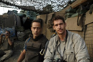 Tim Hetherington (r) with <i>Restrepo</i> co-director Sebastian Junger