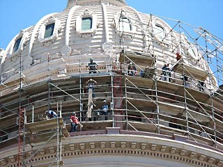 Prepping for paint: Workers set up scaffolding around the Capitol dome before adding a new coat of paint to spruce up the historic structure.