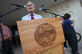 The annual Labor Day fish fry event, a long-held Austin tradition of the Texas AFL-CIO, gives officeholders and candidates a chance to meet, greet, eat, and speak – this time at a brand-new podium, shown here with U.S. Rep. Lloyd Doggett. Constable Bruce Elfant handcrafted the podium as a gesture of thanks to the union hall for serving as host location for Elfant's annual ice cream socials over  the years.