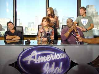 Judgment day: <i>Idol</i> judges (seated, l-r) Simon Cowell, Paula Abdul, Randy Jackson; and hosts Kristin Holt and Ryan Seacrest