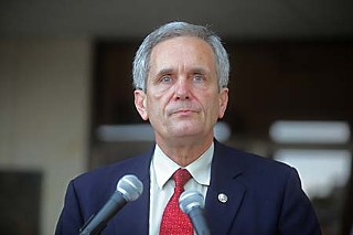 Congressman Lloyd Doggett (above) and Gov. Rick Perry are in a war of words over public education funding.