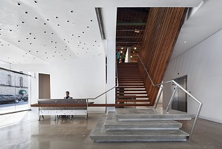 Watch your step (become part of the desk). Arthouse's new lobby and stairway to the second floor gallery