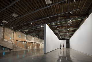 Mobile wall: the second-floor gallery's sliding panel positioned in the middle of the space