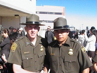 Bryan Gonzalez (r) at his graduation ceremony to become a U.S. Border Patrol agent – a job he lost after talking to a co-worker about the drug war