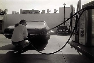 Gassing up Baby. Photograph &copy;1988 Butch Hancock. From <i>If I Was a Highway</i>, &copy;2011 Michael Ventura. Reprinted by permission of the publisher, Texas Tech University Press, <b><a href=http://www.ttupress.org/>www.ttupress.org</a></b>.