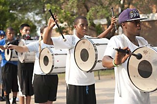 The Austin All-Stars' tenor drum section runs through drills before rejoining the entire band for practice.