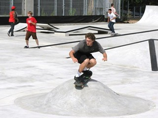 A young skateboarder gets to break in the half pipe at the Austin BMX & Skate Park, June 16, 2011