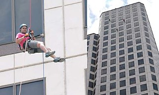 Josh Martinez rappels the 32 stories of One American Center, raising money for the Make-a-Wish Foundation.